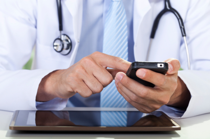 Healthcare professional using a smartphone.
