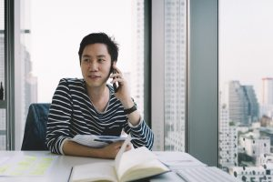 An MBA student talks on the phone while studying abroad.
