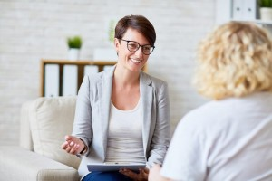 Counselor smiling at client