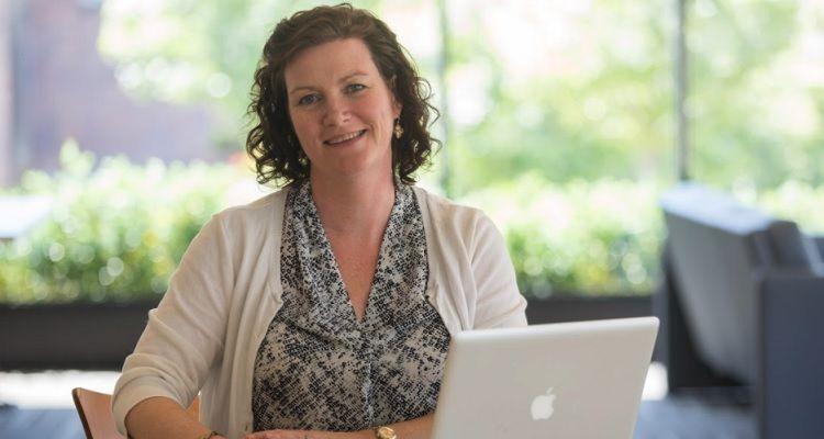 Smiling nurse at laptop