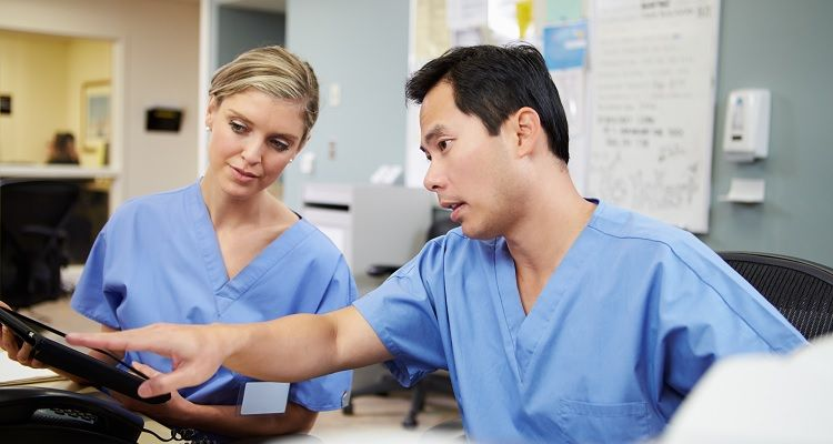 Nurses reviewing information on tablet