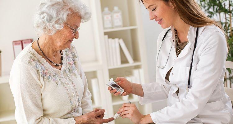Nurse checking patient blood sugar level