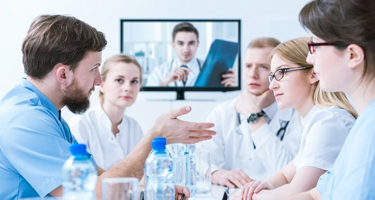 Medical staff engaged in conversation meeting