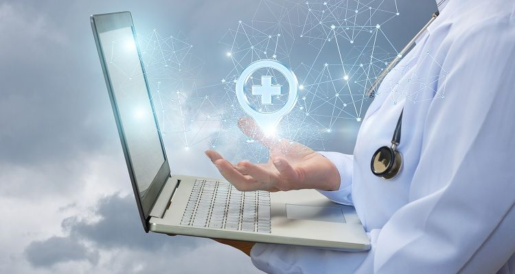 Nurse holding laptop with medical location icon