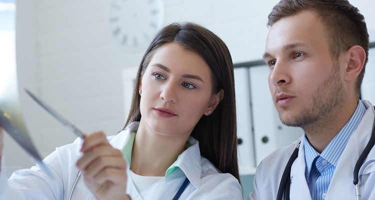 Doctor and nurse reviewing information