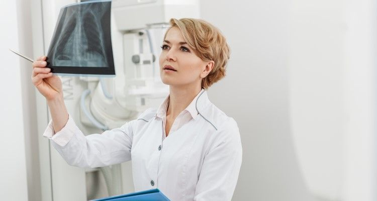 Nurse examining Xrays