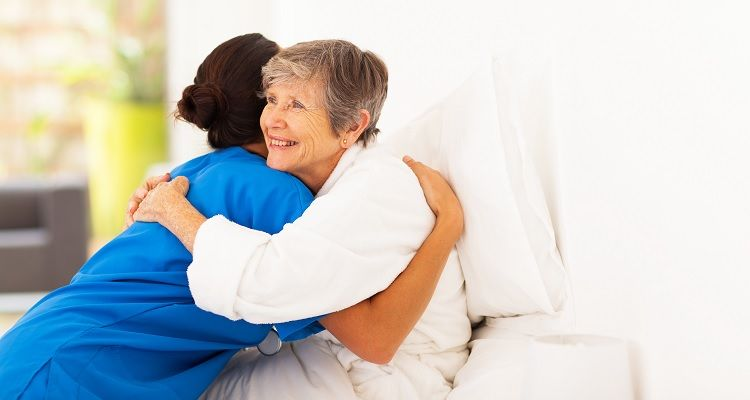 Nurse hugging patient