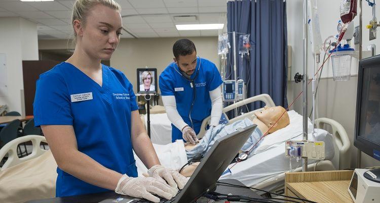 Nurses practicing on test dummy