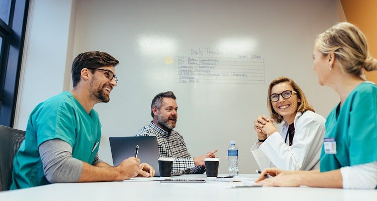 Nurse and team having a meeting
