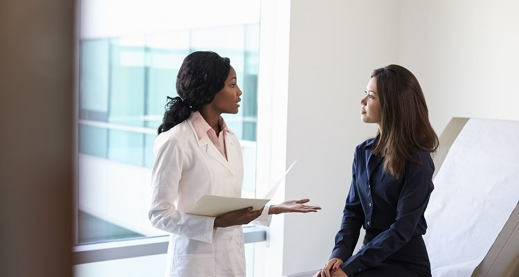 Doctor reviewing information with patient