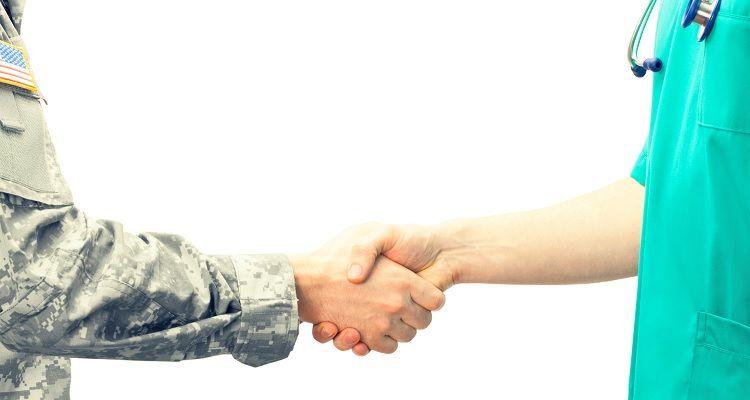Military troop and civilian nurse shake hands