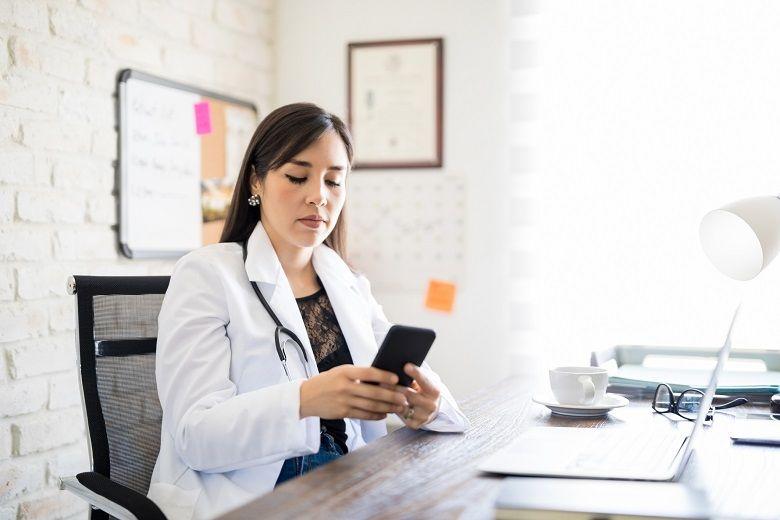 Nurse looking at smartphone