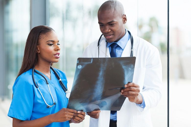 nurse going over xray with doctor