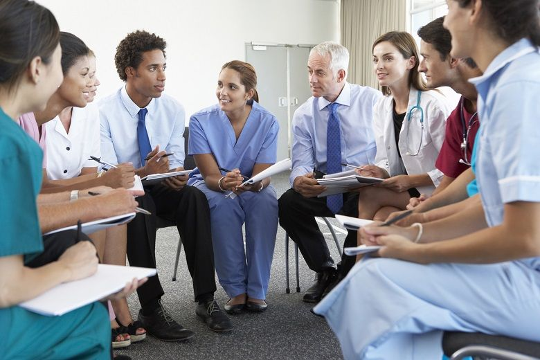 Nurses, doctors, and administrators in a meeting
