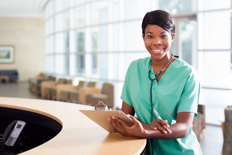 female nurse holding clipboard