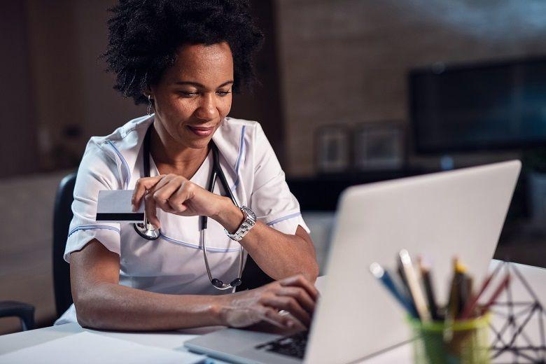 nurse looking at her laptop