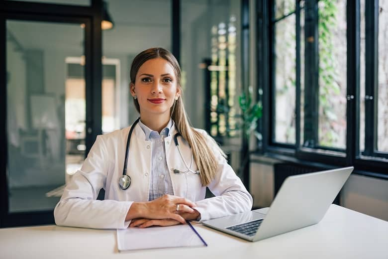 female nurse sitting with her laptop