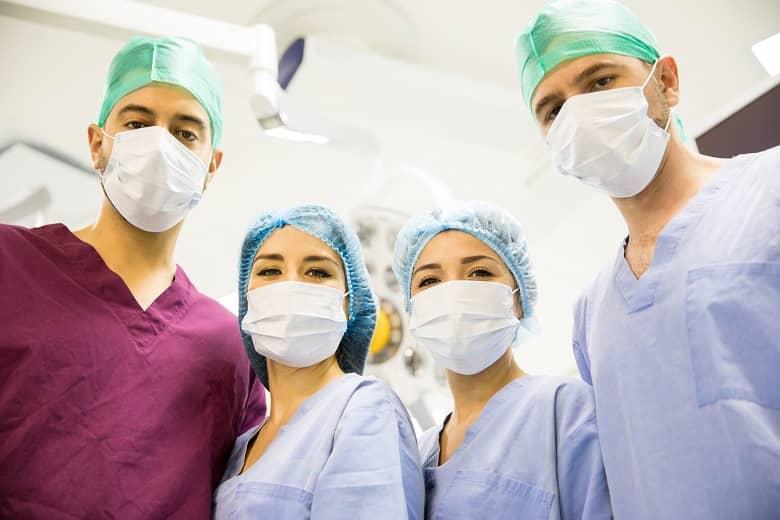 four nurses standing together