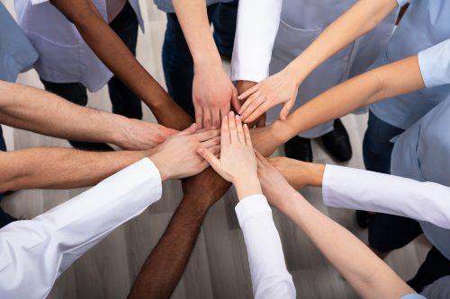 Directly Above Shot Of Medical Team Stacking Hands Together At Hospital.