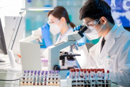 A medical technician analyzes a blood sample
