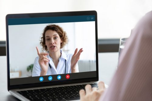 A nursing instructor teaches a class online.