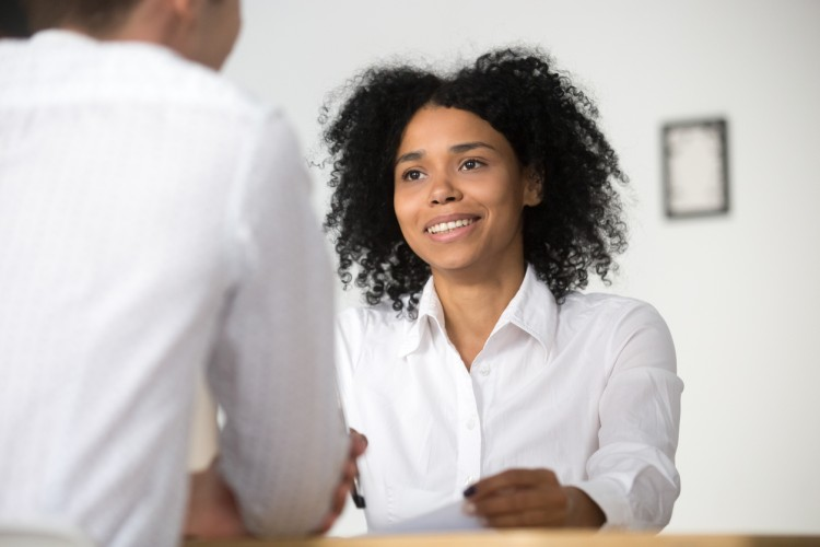 A nurse practitioner discusses contract terms with her potential employer.