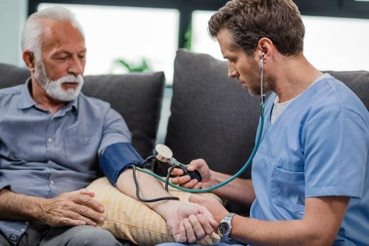 A nurse is measuring a man's blood pressure.