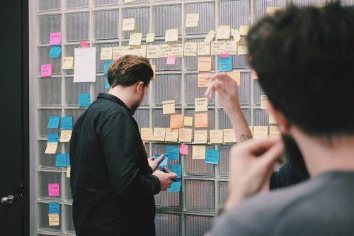 People using an idea board.