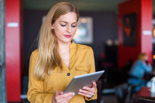 A woman reading her iPad.
