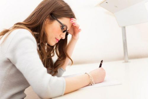 A female student taking an exam.