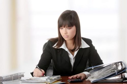 An accountant works with tax documentation