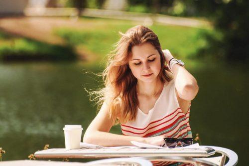 Finance student doing her homework outside