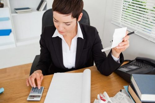 A corporate auditor examines financial figures