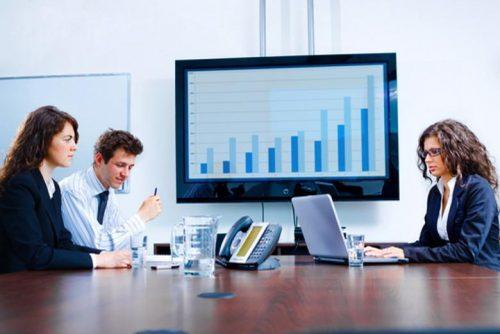 CIO and CTO departmental leaders meet in a boardroom