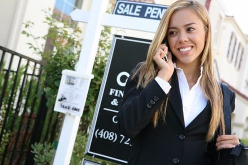A real estate broker makes a call about a pending sale