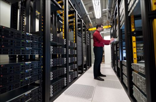 An information systems manager inspects servers.