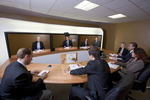 Professionals attending a video conference