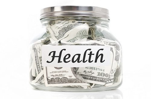 Jar full of money with the word Health on it