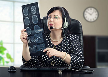 Woman looking at scans while wearing a headset