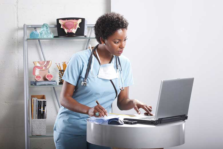 Nurse checking patient data on a laptop