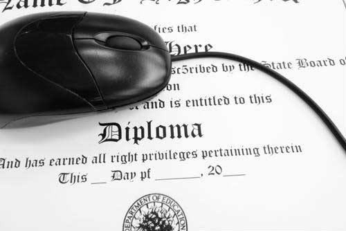 Mouse resting on top of a diploma