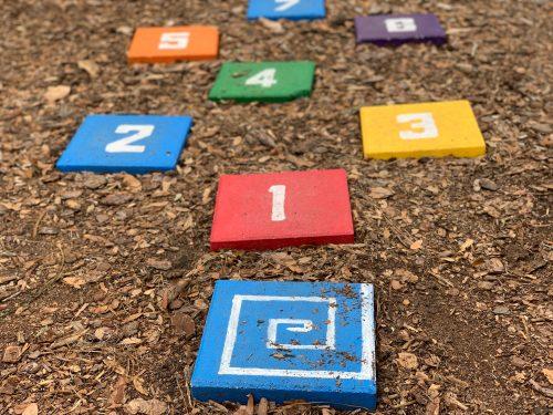 Kids colored hopscotch tiles.