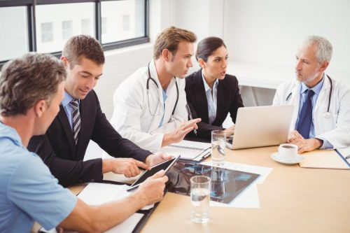 Information experts sit down with healthcare workers to discuss data.