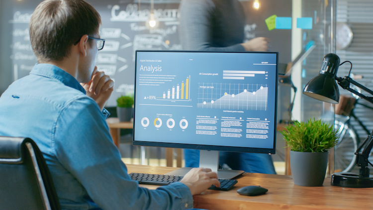 Business analyst looks at digital data chart