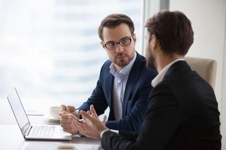 Business associates discuss over a meeting.