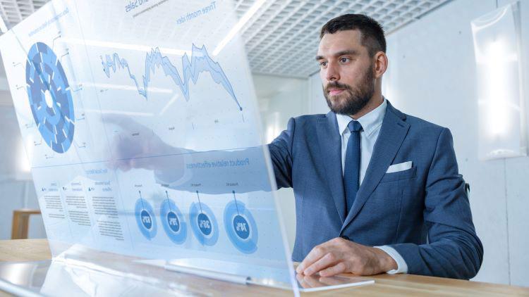 Business analyst studies data visualization chart