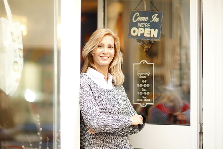 An entrepreneur in the entrance of her business