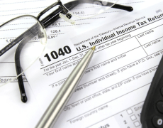 tax form with glasses