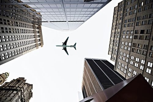 plane flying over city