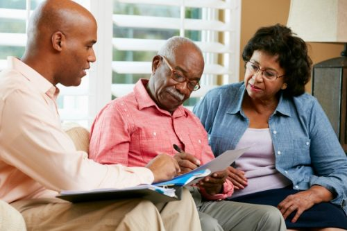 A tax lawyer consults with clients on an estate plan.